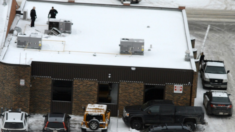 Lethbridge police inspect the roof of Able Family Dentistry on Fifth Street S. after three people broke into the office through the ventilation system.