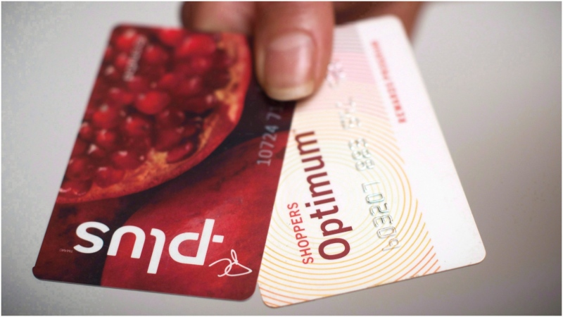 A Loblaws PC Plus and a Shoppers Drug Mart Optimum card are shown together. THE CANADIAN PRESS/Graeme Roy