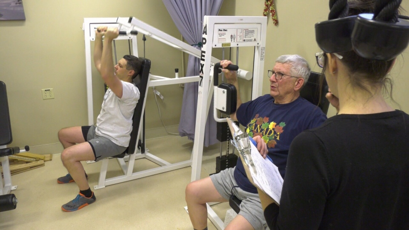 Father and son working out, cancer research at UofA