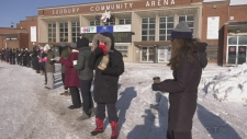 Human chain passing soup in downtown sudbury
