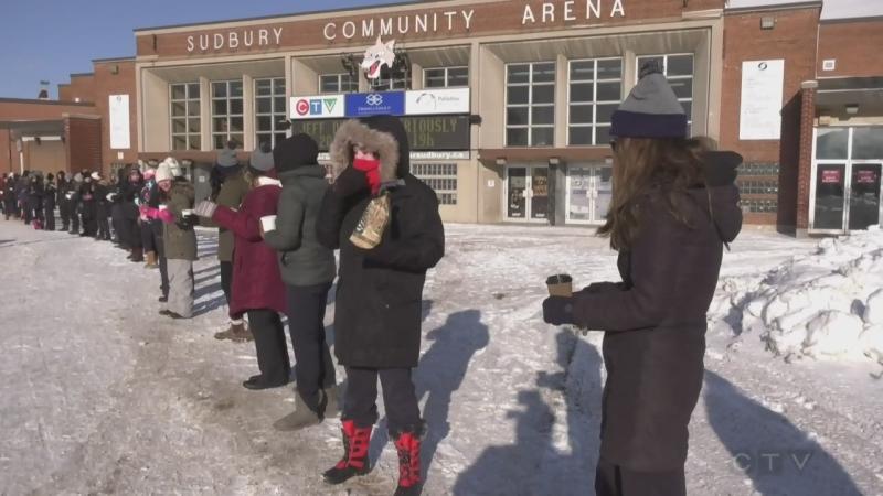 Human chain passing soup in downtown sudbury