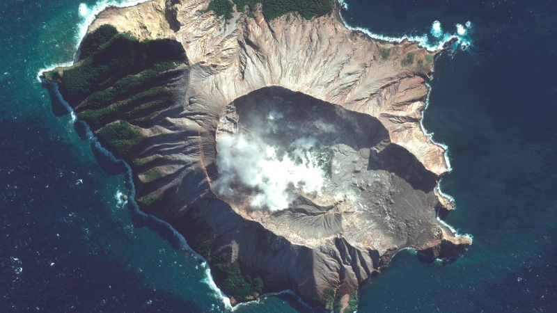 In this satellite image taken and released on May. 12, 2019, by Maxar Technologies steam rises from the volcano on White Island off the coast of Whakatane, New Zealand. (Satellite image ©2019 Maxar Technologies via AP)