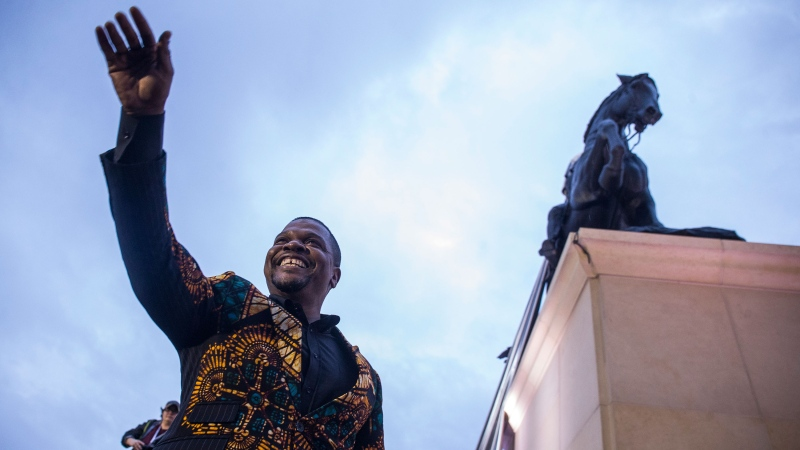 Artist Kehinde Wiley acknowledges the crowd during an unveiling ceremony for his statue, Rumors of War. (Zach Gibson/Getty Images)