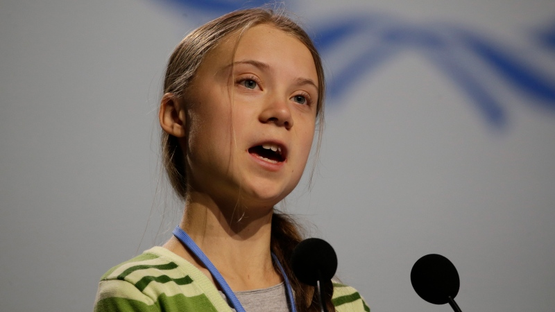Swedish climate activist Greta Thunberg addresses plenary of UN climate conference during with a meeting with leading climate scientists at the COP25 summit in Madrid, Spain, Wednesday, Dec. 11, 2019. (AP Photo/Paul White)