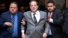 Harvey Weinstein, center, leaves court following a bail hearing, Friday, Dec. 6, 2019 in New York. (AP Photo/Mark Lennihan)