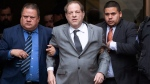 Harvey Weinstein, center, leaves court following a bail hearing, Friday, Dec. 6, 2019 in New York. (AP Photo/Mark Lennihan)