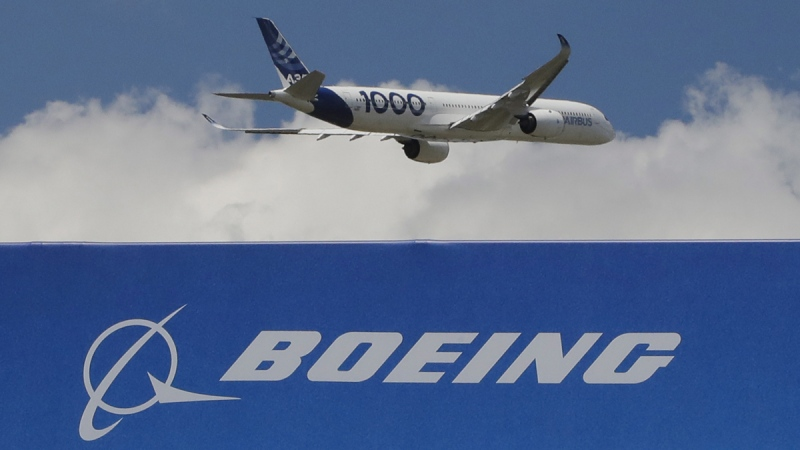 A Boeing sign is seen as an Airbus A350-1000 demonstration flight at the Paris Air Show, June 17, 2019. (Michel Euler / AP)