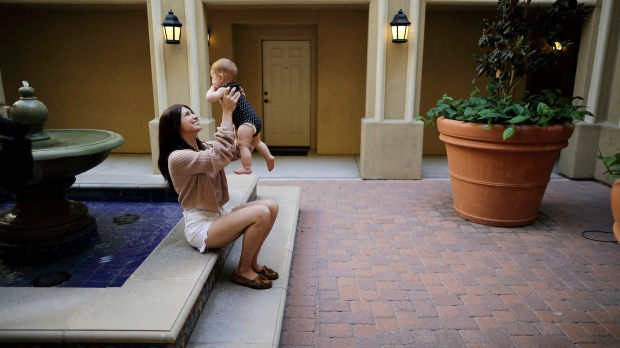 In this Aug. 24, 2018 file photo Keira Sumimoto plays with her daughter, in Irvine, Calif. Sumimoto, who used marijuana briefly for medical reasons while pregnant and breastfeeding, says her daughter is healthy and advanced for her age. (AP Photo/Gregory Bull)