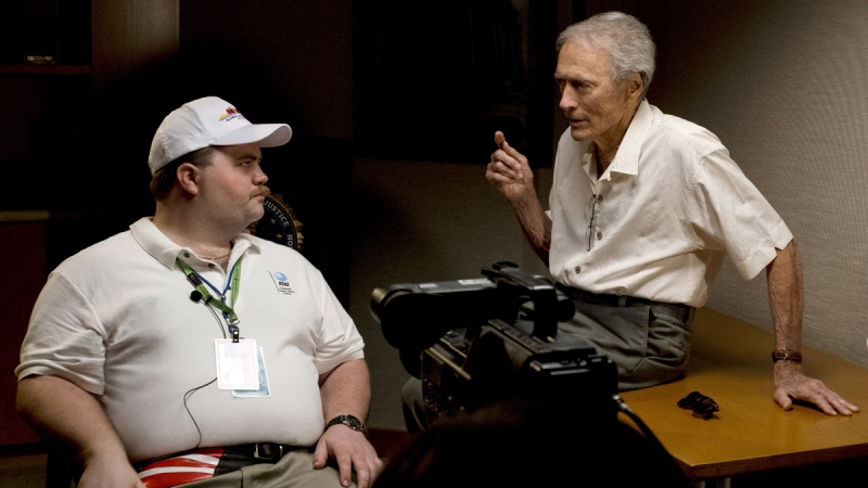 Clint Eastwood speaks with actor Paul Walter Hauser during filming of the movie 'Richard Jewell.' (Claire Folger / Warner Bros. Pictures via AP)