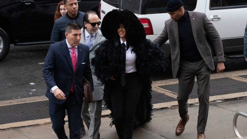 Rapper Cardi B arrives at Queens Criminal Court on charges stemming from an 2018 fight at a Queens strip club, Tuesday, Dec. 10, 2019 in New York. Prosecutors obtained a felony indictment in June. (AP Photo/Mark Lennihan)