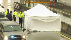 A tent surrounds a man's body on Highway 99 in Richmond on Saturday, Dec. 7, 2019.