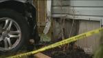 Vehicle strikes pedestrian, crashes into home