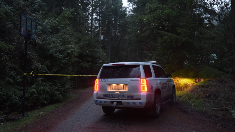 An RCMP vehicle blocks a road near the the scene of a small plane crash on Gabriola Island, B.C., early on Wednesday, Dec.11, 2019. The BC Coroners Service and police have confirmed multiple fatalities in a plane crash off the east coast of Vancouver Island.THE CANADIAN PRESS/Jonathan Hayward