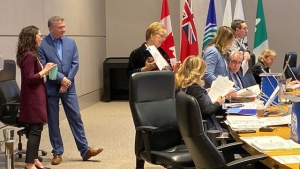 Several city councillors refused to take their seats at the start of council Wednesday, Dec. 11, 2019, as they joined demonstrators who arrived to protest the presence of embattled College Ward Councillor Rick Chiarelli.
