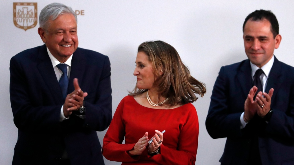 Mexico's Treasury Secretary Arturo Herrera, right, Deputy Prime Minister of Canada Chrystia Freeland, centre, and Mexico's President Andres Manuel Lopez Obrador applaud after signing an update to the North American Free Trade Agreement, at the national palace in Mexico City, Tuesday, Dec. 10. 2019. (AP Photo/Marco Ugarte)