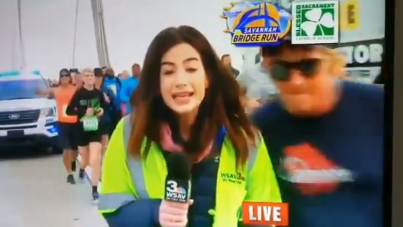 Tommy Callaway runs up behind TV reporter Alex Bozarjian and smacks her buttocks during a marathon in Savannah, Ga. (Twitter / @GrrrlZilla)