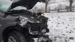 A pickup truck is damaged after police say it collided with a farm vehicle near Listowel, Ont. on Wednesday, Dec. 11, 2019.