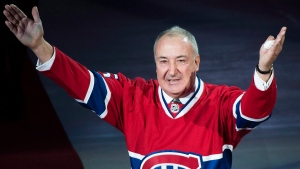 Former Montreal Canadien Guy Lapointe salutes the crowd as his number is raised during a retirement ceremony prior to an NHL hockey game between the Canadiens and the Minnesota Wild in Montreal, Saturday, November 8, 2014. (THE CANADIAN PRESS/Graham Hughes)