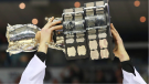 Edmonton Oil Kings captain Griffin Reinhart lifts the Memorial Cup after beating the Guelph Storm in the championship game of the Memorial Cup CHL hockey tournament in London, Ont., on Sunday, May 25, 2014. (THE CANADIAN PRESS/Dave Chidley )