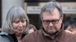 Clayton Babcock, right, stands next to his wife Linda as he reads a prepared statement outside court in Toronto on Saturday, December 16, 2017. THE CANADIAN PRESS/Chris Young