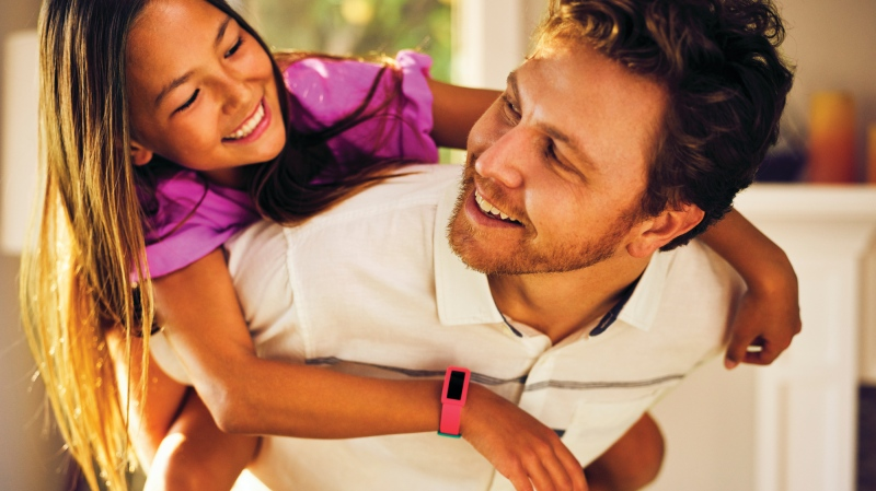 Young girl wears Fitbit Ace 2. (Fitbit)