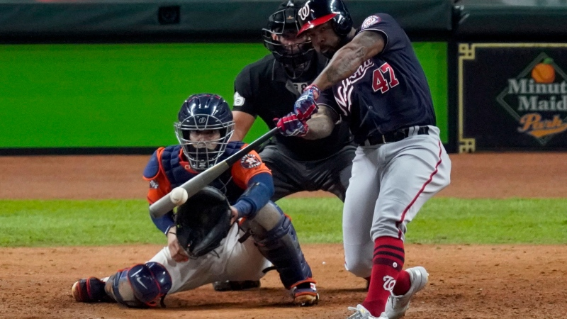 In this Oct. 30, 2019, file photo, Washington Nationals' Howie Kendrick hits a two-run home run against the Houston Astros during the seventh inning of Game 7 of the baseball World Series, in Houston.  (AP Photo/Eric Gay)