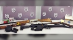 Police seized a number of weapons, including a prohibited, 50-round drum magazine. (ALERT)