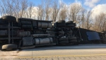 A transport truck rollover closed Highway 401 at Colonel Talbot Road west of London, Ont. on Wednesday, Dec. 11, 2019. (@OPP_WR / Twitter)