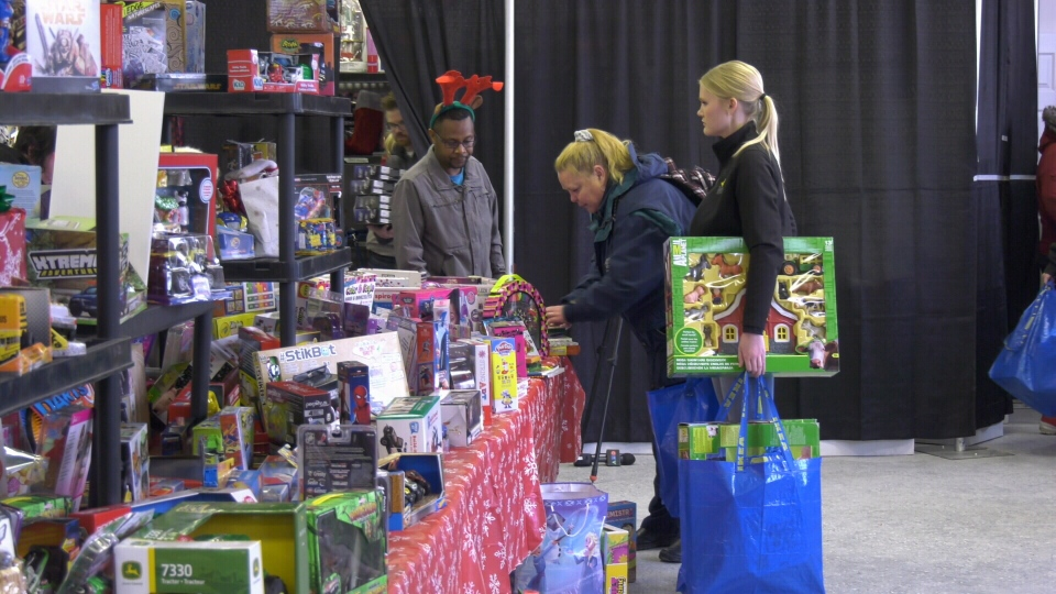 Catherine shops for gifts for her five grandchildren at the fourth annual Mustard Seed Family Gift Centre.