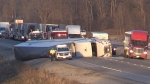 An overturned transport truck blocked all lanes of Highway 401 west of London, Ont. on Wednesday, Dec. 11, 2019. (Jim Knight / CTV London)