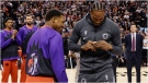Former Toronto Raptors and now LA Clippers forward Kawhi Leonard, right, receives his 2019 NBA championship ring from Raptors' Kyle Lowry prior to NBA basketball action in Toronto on Wednesday, December 11, 2019. THE CANADIAN PRESS/Nathan Denette