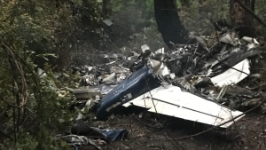 "The scene of a small plane crash on Gabriola Island, B.C., is shown on Wednesday, Dec.11, 2019. A plane that one witness describes as crashing in a ""huge explosion"" that left multiple people dead in British Columbia has been identified as a twin-engine propeller aircraft. THE CANADIAN PRESS/Paolo Gastaldello"