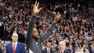Former Toronto Raptors and now LA Clippers forward Kawhi Leonard salutes the crowd as he receives his 2019 NBA championship ring prior to NBA basketball action in Toronto on Wednesday, December 11, 2019. THE CANADIAN PRESS/Nathan Denette