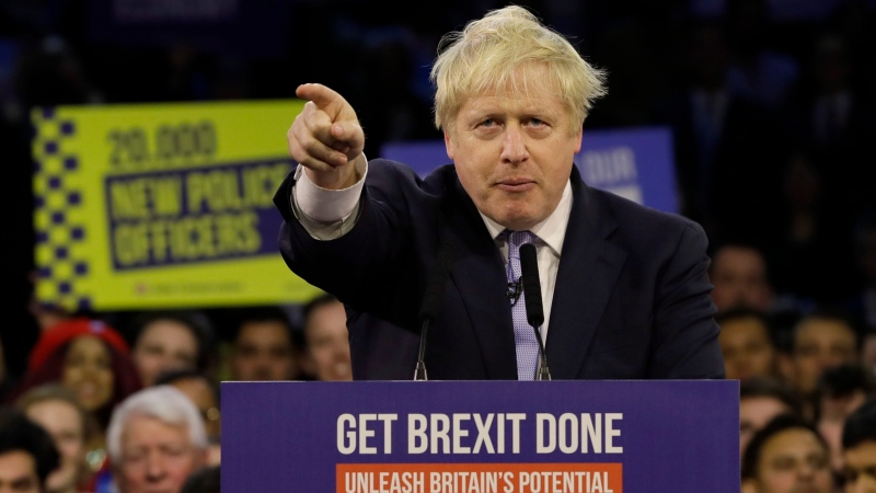Britain's Prime Minister Boris Johnson speaks during his ruling Conservative Party's final election campaign rally at the Copper Box Arena in London, Wednesday, Dec. 11, 2019. (AP Photo/Kirsty Wigglesworth)