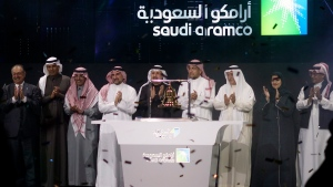 Saudi Arabia's state-owned oil company Saudi Aramco and stock market officials celebrate during the official ceremony marking the debut of Aramco's initial public offering (IPO) on the Riyadh's stock market in Riyadh, Saudi Arabia, Wednesday, Dec. 11, 2019. (AP Photo/Amr Nabil)