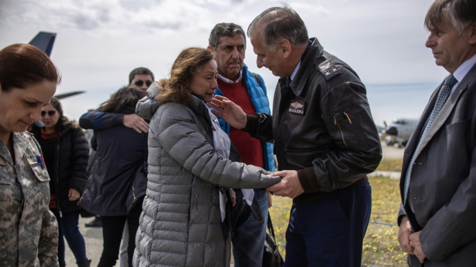 Relatives of people who were aboard the missing Chilean air force plane gathered in Punta Arenas to be close to the rescue effort. (AFP)