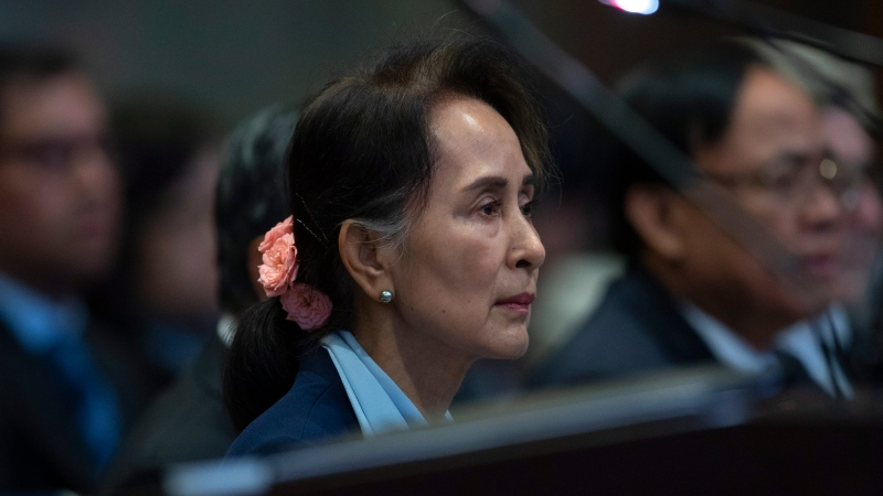 Myanmar's leader Aung San Suu Kyi waits to address judges of the International Court of Justice for the second day of three days of hearings in The Hague, Netherlands, Wednesday, Dec. 11, 2019. (AP Photo/Peter Dejong)