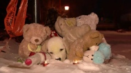 A small collection of toys has appeared on the lawn of a Montreal family found dead in their east end home.
