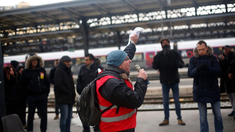 A railway worker gives a speech during a meeting at the gare de l'est Railway station, in Paris, Thursday, Dec. 12, 2019. (AP Photo/Thibault Camus)