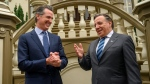 California Gov. Gavin Newsom meets with François Legault, Premier of Quebec, at the Stanford Mansion on Wednesday, Dec. 11, 2019, in Sacramento, Calif. (Renée C. Byer/The Sacramento Bee via AP, Pool)