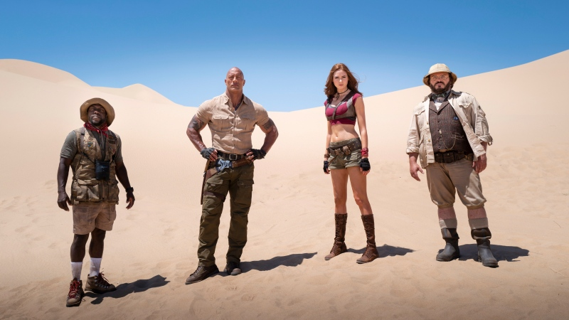 "This image released by Sony shows Kevin Hart, from left, Dwayne Johnson, Karen Gillan and Jack Black in a scene from ""Jumanji: The Next Level."" (Hiram Garcia/Sony via AP)"