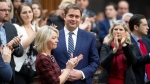 Leader of the Opposition Andrew Scheer is applauded by caucus members as he announces he will step down as leader of the Conservatives, Thursday, December 12, 2019 in the House of Commons in Ottawa. THE CANADIAN PRESS/Adrian Wyld