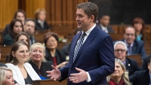 Leader of the Opposition Andrew Scheer turns and speaks to Conservative MP's as he announces he will step down as leader of the Conservatives, Thursday December 12, 2019 in the House of Commons in Ottawa. THE CANADIAN PRESS/Adrian Wyld