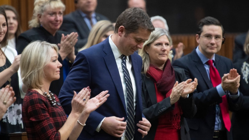 Conservative Members of Parliament applaud party Leader of the Opposition Andrew Scheer after he announced he will step down as leader of the Conservatives, Thursday December 12, 2019 in the House of Commons in Ottawa. (THE CANADIAN PRESS/Adrian Wyld)