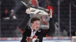 Canada's Alexis Lafreniere (11) hoists the Hlinka Gretzky Cup following the Hlinka Gretzky Cup gold medal game against Sweden, in Edmonton on Saturday, August 11, 2018. (THE CANADIAN PRESS/Codie McLachlan)