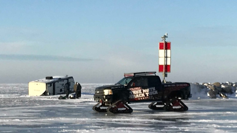 Brandon Friesen, the owner of True North Track Truck — a towing service with a pickup truck outfitted with tracks instead of wheels, was on site Thursday morning scoping out the situation to assist with the recovery. (Source: Josh Crabb/ CTV News Winnipeg)