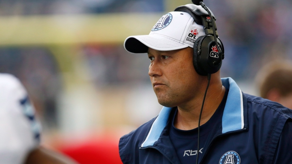 File photo: Former Edmonton Football Team head coach, Scott Milanovich coaching with the Toronto Argonauts on the sidelines during the first half of CFL action against the Winnipeg Blue Bombers in Winnipeg Thursday, June 26, 2014. (John Woods / THE CANADIAN PRESS)