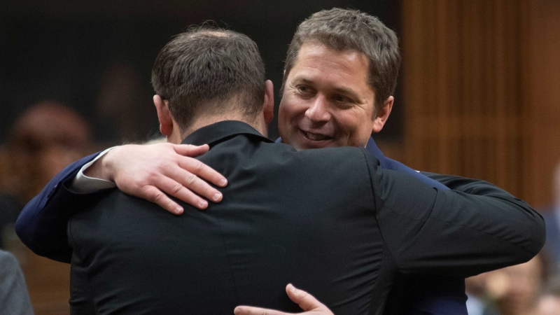 Conservative MP's pay their respects to Leader of the Opposition Andrew Scheer following the announcement he will step down as leader of the Conservatives, Thursday December 12, 2019 in the House of Commons in Ottawa. THE CANADIAN PRESS/Adrian Wyld