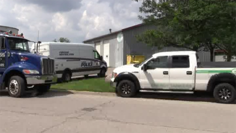 Police search of a business in east London, Ont. on Monday, July 29, 2019. (Gerry Dewan / CTV London)