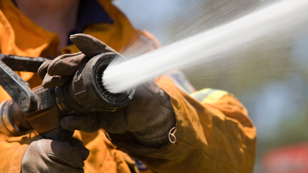 Firefighter with water hose